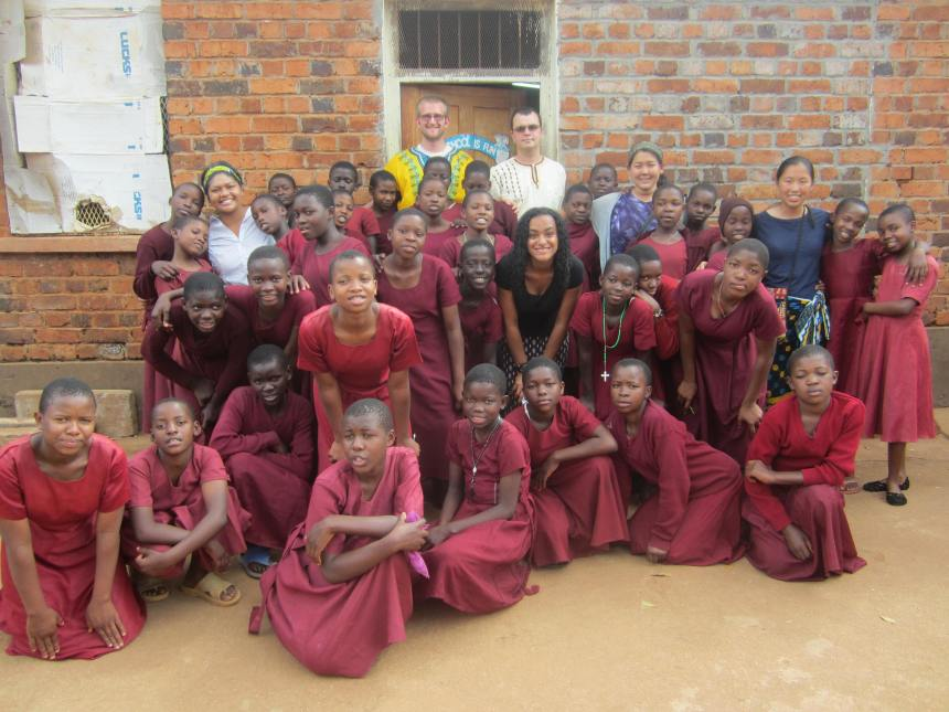 The group of SMU students pose with the students at the primary school.