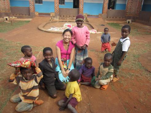 Amy Pollard spends time with some of the orphans.