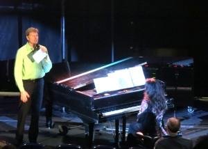 Darrell Born, choir director, introducing the choir