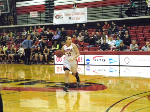 MacKenzie Taylor dribbles down the court