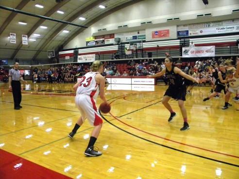 Megan Weideman dribbles the ball looking for an open teammate