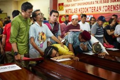 Family grieve over coffins of JT610 victims